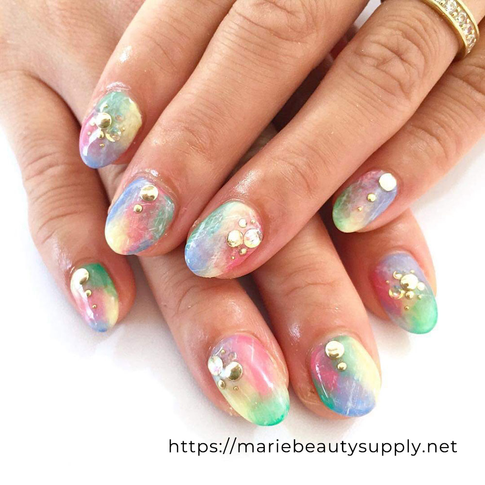 Nail Design with Colorful Base and Studs.