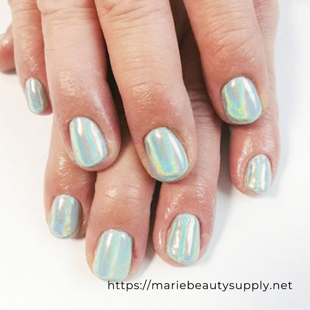 Simple Nail Design with Unicorn Powder on Mint Green.