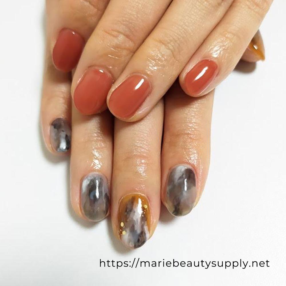 Asymmetric Tie-Dye Nails.