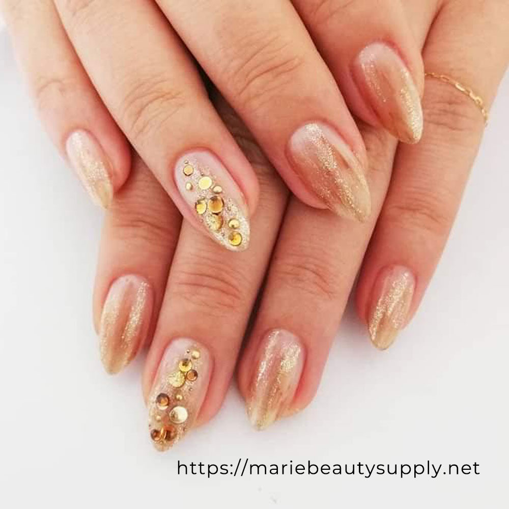 Gold and glitter Nuance Nails.