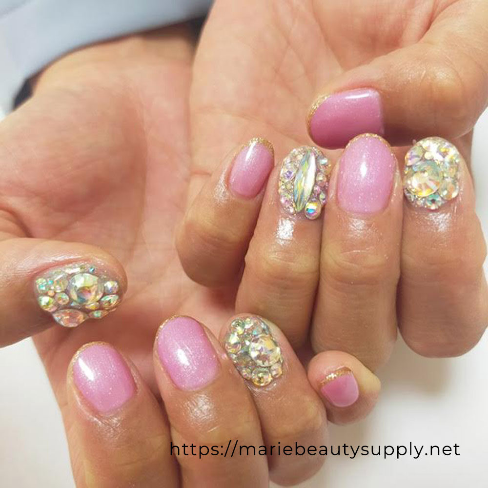 Stone-Filled Pink Nails.