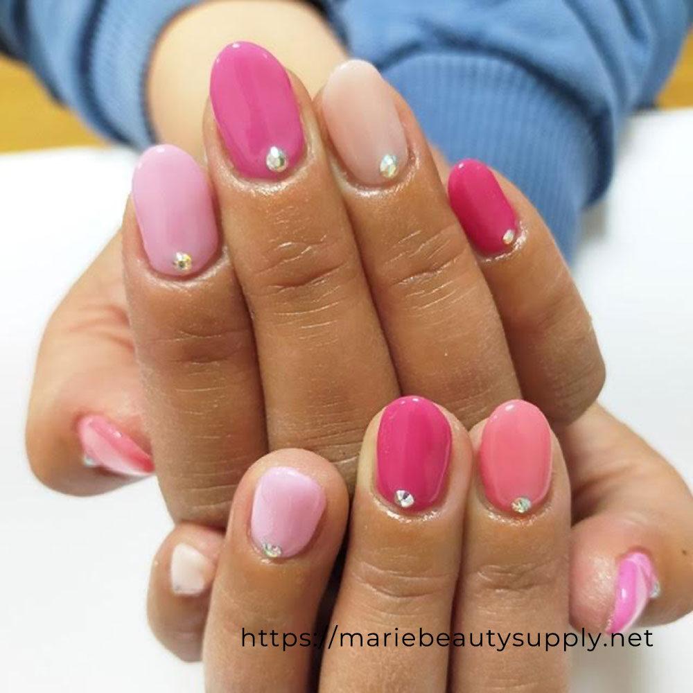 Simple Nails Using Various Pink Shades.